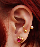 Conch Piercing with Gold Twister Barbell