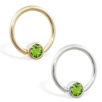 14K yellow gold captive bead ring with Peridot